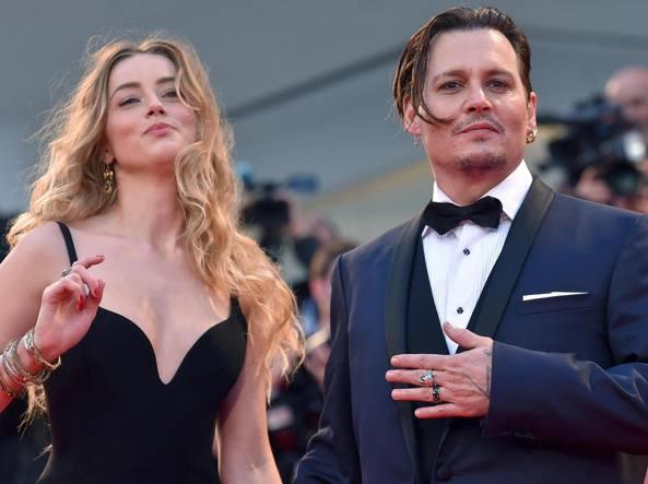 Amber Heard con il neo marito Johnny Depp