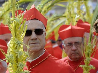 Tarcisio Bertone in una processione   (Ansa)