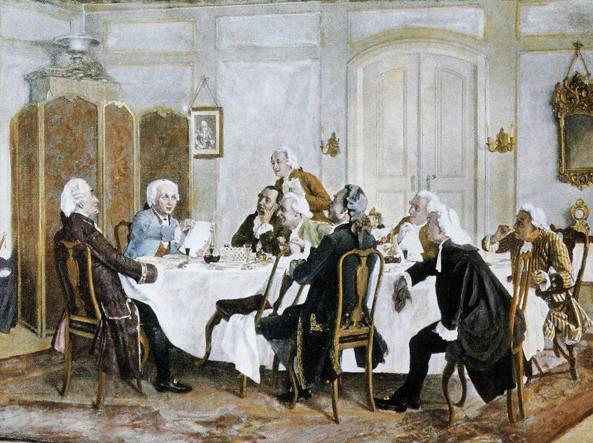 Immanuel Kant (secondo da sinistra) con la giacca azzurra) insieme ai suoi commensali in un quadro del pittore tedesco Emil Doerstling (1859-1940)