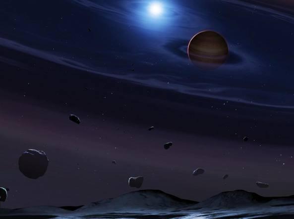 Illustrazione del pianeta con due soli nella costellazione del Cigno: una nana bianca e una nana marrone poco più grande di Giove  (Garlick/Ucl)