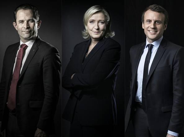 Da sinistra: Benoit Hamon, Marine Le Pen e Emmanuel Macron, tre degli sfidanti nel dibattito televisivo di oggi tra candidati all'Eliseo