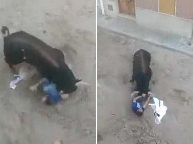 Spagna, si rifugia in un portone ma il toro lo trova e lo incorna