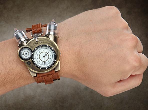 09ef8fa9fb0fc7 L'orologio ha un cinturino in pelle e una cassa in acciaio di color bronzo
