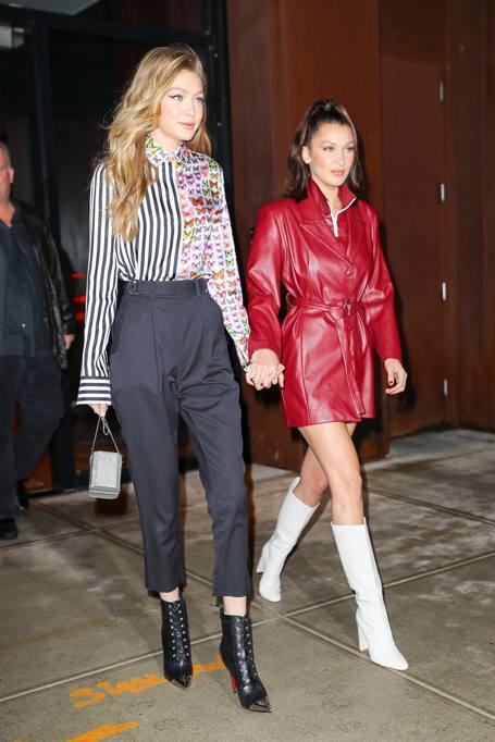 2abae29bfe04 New York  Bella Hadid in pelle rossa e stivali con la sorella Gigi per il  compleanno della madre