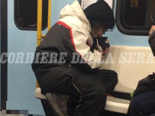 Addicts smoke heroin on Milan metro at rush hour