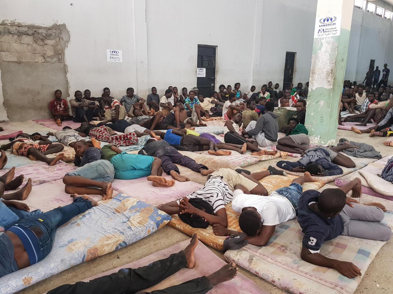 Un campo di detenzione di migranti in Libia (Ansa)