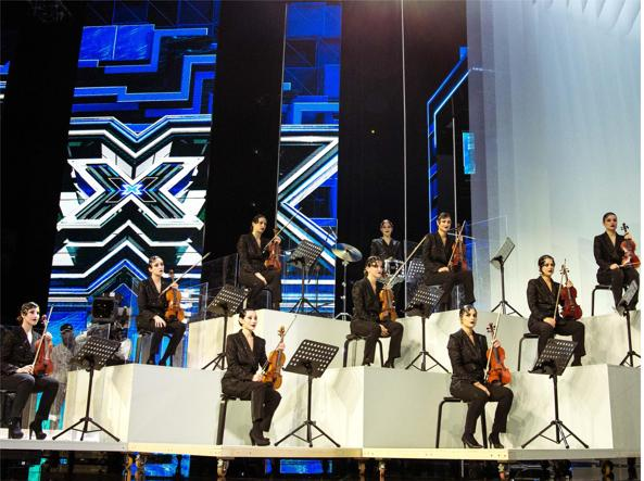 L'orchestra era composta solo dalle donne che hanno accompagnato il monologo di Emma e la prima manche