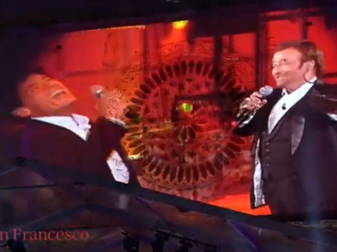 Gianni Morandi canta un medley di Lucio Dalla davanti la Basilica di Assisi: l'emozionante video