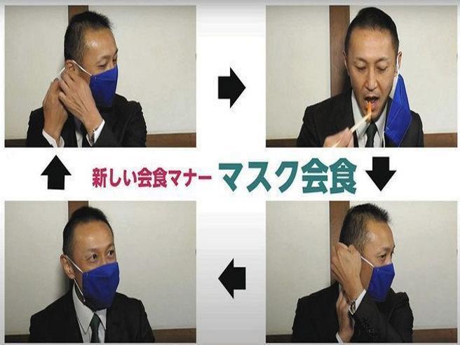Le ferree regole per i giapponesi: tra un boccone e l'altro devono rimettere la mascherina