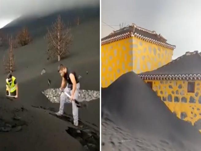Canarie, case sepolte dalla cenere del vulcano e c'è chi spala disperato per salvare qualcosa