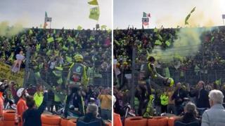 L'ultima di Valentino Rossi, si commuove per la festa e lancia il casco ai suoi tifosi